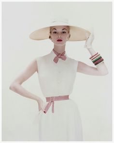 1954...model Jean Patchett...white tucked crepe dress, of Dacron and rayon, tied with red and white stripes, by David Crystal...