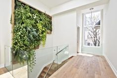 Green wall feature along staircase with automatic irrigation (have skylight overhead, go over 2 stories?).