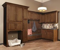 When our team builds for you, we keep every family member in mind...even the furry ones! We love these unique cabinets from Wellborn Cabinet, Inc., that create the perfect nook for your beloved pet.