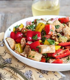 The perfect recipe to use up stale bread, this Sweet Pepper Panzanella recipe is filled with seasonal fresh produce.