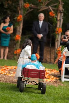 @Christina & Buron  Teal and Orange Wedding Ideas. BEC THIS IS PRETTY!