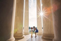 Mother and daughter and Jefferson Memorial with gorgeous sun flare.