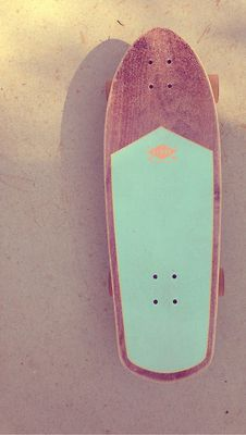 Sick wooden aqua skateboard.