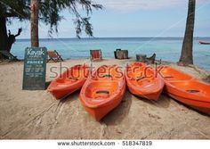 13 NOV 2016 KohTao Island, Thailand kayak boat lay on sand beach with rent cost sign