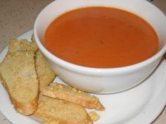 NORDSTROM'S CAFÉ ROMA TOMATO SOUP  Makes 15-20 servings    Ingredients:  •6 T. olive oil  •4 large carrots, sliced  •1 large onion, sliced  •1 T. dry basil leaves  •3 (28-32 oz.) cans whole peeled Roma (or Plum) tomatoes  •1 quart chicken broth  •1 pint heavy or whipping cream    •Salt and pepper, to taste      Directions:  1.Place olive oil in a 6-quart saucepan and heat over medium-high heat. Add carrots, oinion and basil and cook 10 to 15 minutes or until vegetables are soft. Add…