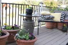 In a few quick steps, I turned a wooden round and an antique milk can into a side table for my deck. Even better, a patio umbrella slips in the center.