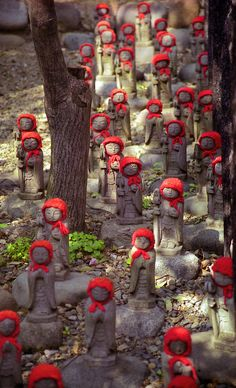 "Jizo statues in Kamakura, Japan. Jizo take care of the souls of unborn children and those who died at a young age. Children ""in limbo"" in Japan are said to go to a place called sai no kawara, where they must create piles of stones into small towers. Kamakura, Japanese Culture, Japanese Art, Japan Kultur, Tokyo, Urbane Kunst, Little Buddha, Turning Japanese, Yarn Bombing"