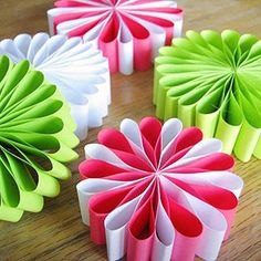 Paper Loops:  Get a little loopy while making these flower-inspired paper ornaments. Cut strips of paper from fun florescent colors, and then stack and staple them together in the center. Bend the petals into the center and attach them with double-sided tape until you've got a completely looped together flower.