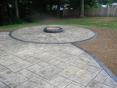 Patio with an extension for a fire pit.
