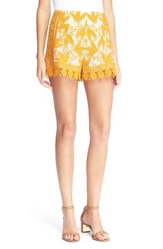 Ringing in the sunshine with these cheery yellow shorts from Tory Burch! The overlapping layers of two-tone lace create lavish texture while playfully sheer hems add some sass.