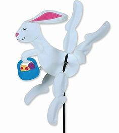 "12"" Easter Bunny Whirligig from the Whirligig Spinners Collection by Premier. The lightweight SunTex fabric legs spin in even the lightest of breezes and are made to last all season long. The fun design is sure to liven up your yard or garden. His body is approximately 12.25"" W x 12"" H with 20"" diameter spinners. Comes with a 7"" ground stake that holds spinner upright and holds well in dirt, sand, gravel and grass **Free Priority Mail shipping to anywhere in the USA.**"
