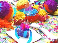 Super-colorful favor packaging - heart-shaped woven boxes with ribbons and straw pompoms