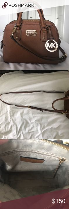 Michael Kors cross body leather bag Michael Kors cross-body leather bag. Tan, gently used with some scratches on the metal as pictured. Inside is clean, smoke-free home. includes adjustable/removable long strap! Michael Kors Bags Crossbody Bags