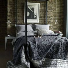 Love the whole look of this bedroom. The hanging lights, the exposed brick, the bed, the bedding...