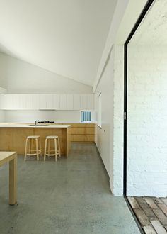 Tribe Studio // House Kalafatas Challita // paint brick; timber cabinets; polished concrete floor