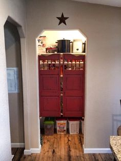 Saloon doors for the pantry. So cute! No one ever closes the door anyway.