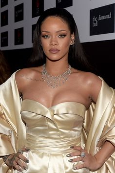 Rihanna Stuns in Sexy Gold Gown at Diamond Ball, Gushes Over 'Feisty' Baby Cousin Majesty. Rihanna shines bright like a diamond at her second annual Diamond Ball held http://justgetideas.com/rihanna-looks-stuns-gold-dior-gown-2nd-annual-diamond-ball/ [...]