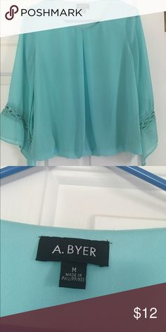 Aqua in color A . Byer blouse in medium Aqua colored A. Byer blouse in size medium. Has pretty detail in the sleeves and elastic in the bottom. Never worn, no stains or holes, and from smoke free home! Amy Byer Tops Blouses