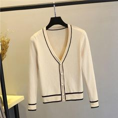 Keep your wardrobe stylish in this trendy, knitted, v neck stripe cardigan sweater. Long Sleeve Sweater Dress, Sweater And Shorts, Sweater Cardigan, Faux Fur Hooded Coat, Striped Cardigan, Striped Sweaters, Winter Coats Women, Sweater Fashion, Cardigans For Women