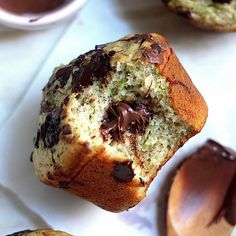 Celebrate world Nutella day with a batch of Nutella Stuffed Chocolate Chunk Muffins http://bakerbynature.com/nutella-stuffed-chocolate-chunk-zucchini-muffins/