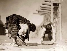 Above we show a remarkable photo of Tewa Indians Cleaning Wheat. It was captured in 1905 by Edward S. Curtis. The illustration documents Two Tewa people processing wheat outside a pueblo structure, San Juan Pueblo, New Mexico.