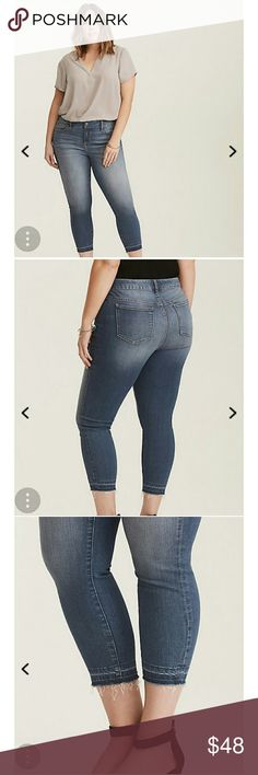 Torrid Cropped Skinny Jeans The medium wash Premium Stretch denim -  combines super stretch with extra recovery, aka lets your body move without fear of stretching out - has also been whiskered and faded beyond belief so it already looks like you've had these forever.  Mid-rise Size 18 torrid Jeans Skinny