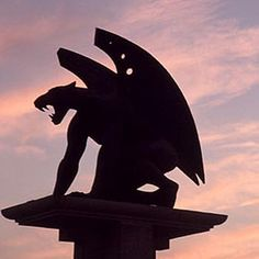 Gargoyles are sculptured creatures that are used as rain spouts; any other sculptured creatures on buildings are called grotesques.