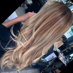 Long straight hair with small curls at the bottom like the color