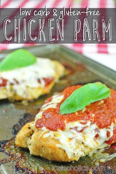 Low Carb & Gluten-free Chicken Parmesan. Crispy on the outside and juicy on the inside! Breaded with pork rinds and parmesan cheese! More recipes like this at www.tasteaholics.com