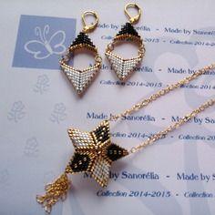 2014/046 - parure pendentif + chaine + boucle d'oreille - style etoile 3d et fleche - tissage peyote - perle en doré noir et blanc