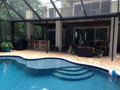 Tanning area on the roof??Jacksonville Swimming Pool & Spa Photo Gallery | View Pictures of Custom Pools & Spas, Paver Decks, Waterfalls, Screen Enclosures, Firepits