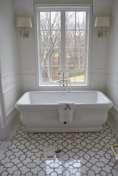 Mosaic floor for master?  Tub for Mireille's room!