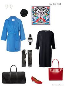 cool weather travel outfit of a black dress with blue coat and red leather accessories