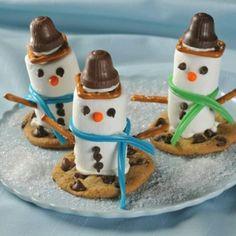 Marshmallow snowmen sledding on chocolate chip cookies