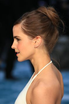 Emma Watson attends the UK Premiere of 'Noah' at Odeon Leicester Square on March 31, 2014 in London, England. Emma is wearing a Ralph Lauren Collection dress, Jimmy Choo shoes, Monica Vinader rings, Anito Ko earrings, and Jennifer Fisher cuffs.