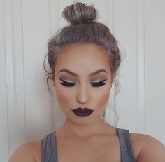 Description: Black cat eyes, fake eyelashes, dark lipstick and perfect brows. Useful: I don't have long eyelashes and i don't know how to put on fake eyelashes so knowing how to do that would be very useful. Also i can't put on eyeshadow so having my eyeshadow look like hers would be very useful, because I would match my eyeshadow to my outfits and it would look like it all goes together.