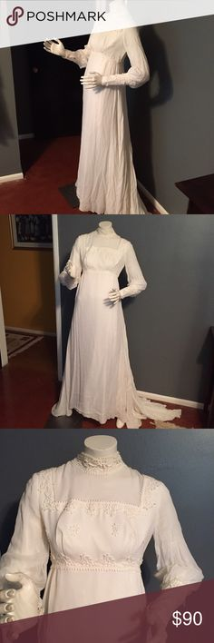 """Vintage wedding dress. Vintage wedding dress. Colour is ivory. Has full slip. Slight discoloration on the right front portion of the underarm, other wise great condition. I'm sure with a good cleaning this could come out. Length in front 57"""",length in back 80"""" bust 34"""", waist 30"""", sleeve 23"""". Not sure of fabric but the slip portion is light and airy.  See posting following this for extra pictures showing discoloration. Vintage Dresses"""
