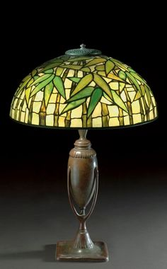 Tiffany Studios ''BAMBOO'' TABLE LAMP shade stamped TIFFANY STUDIOS NEW YORK 1448, base stamped 444/ TIFFANY STUDIOS/NEW YORK leaded glass and patinated bronze 23 1/4 in. (59 cm) high 15 7/8 in. (40.3 cm) diameter of shade ca. 1910