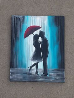 couple under red umbrella  in the rain