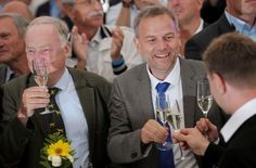 Top candidate Holm and Gauland of the anti-immigration party Alternative for Germany (AfD) react after first exit polls during the Mecklenburg-Vorpommern state election at the party post election venue in Schwerin