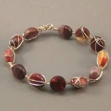 wire wrap beaded bracelet. Pick the colour bead you like and this becomes very versatile.