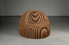 Unique cardboard chair, this is stylish yet very complicated in design. It's structure would be very sturdy though.