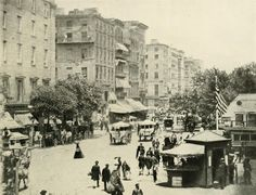View of a busy Broadway in New York City, New York, 1861. A military recruitment office is visible in the bottom right. From Miller's Photographic History of the Civil War.