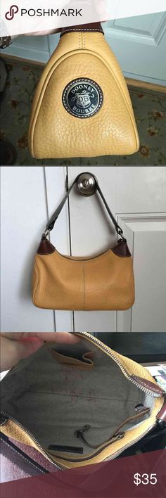 """Dooney Bourke Wayfarer AWL2 Tan Hobo Authentic Dooney and Bourke Tan Hobo. Good condition! Minor wear on the outside, some staining inside. From the Dooney and Bourke AWL2 Wayfarer line. Measures 11"""" X 7"""" X 5"""". Strap drop 7"""".  A brighter tan/gold-2nd pic shows closest color.  Smoke/pet free home!  See my other fabulous listings! Dooney & Bourke Bags Hobos"""