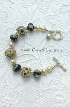 Beautiful champagne lampwork and pearl by KCorrellCreations