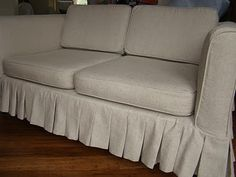 White denim sofa slipcover via Much To Do With Nothing
