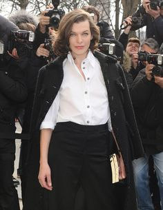 Milla Jovovich's menswear-inspired ensemble is exactly what I think of when I picture an elegant, casual Parisian woman. Her gold Chanel Box Clutch isn't too bad either.