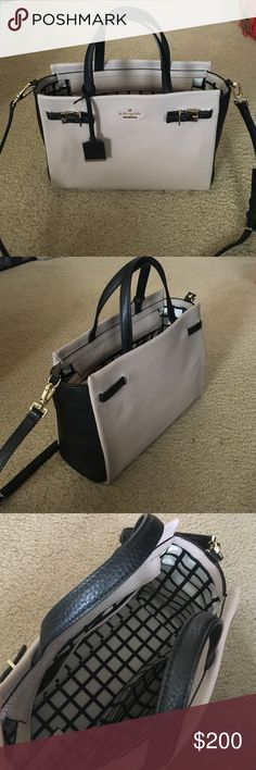 Gorgeous Kate Spade Purse My mom bought this for my birthday just not my style. Comes with dust bag and tags not attached.  Has a long adjustable strap that can be removed. Can fit an 11in Mac book easily probably a 13in as well. kate spade Bags