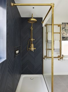 Designed by Drummonds' Bathroom Design Service, this townhouse bathroom has a sophisticated urban edge. Drummonds' classic bathroomware is beautifully set within a simple, modern interior, putting all the design focus onto the gleaming brass, marble and china. The pieces chosen are all on a grand scale; underlining the luxury of having a large bathroom with space for dramatic pieces such as the spectacular double vanity drummonds-uk.com