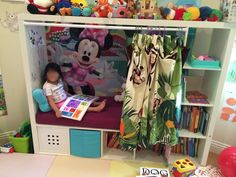 Children's reading nook from TV furniture - IKEA Hackers.. could also be a bed.